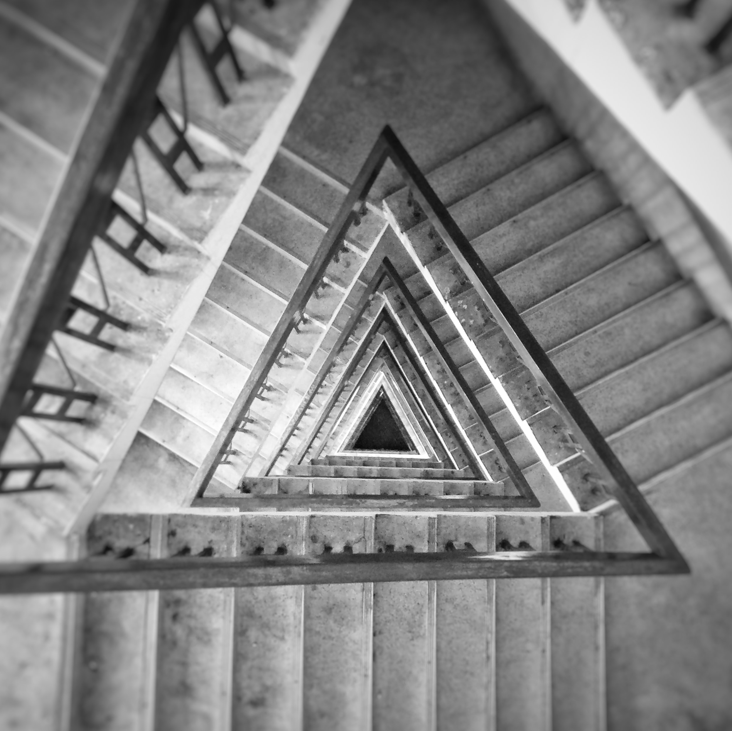 high-angle grayscale photography of triangular staircase