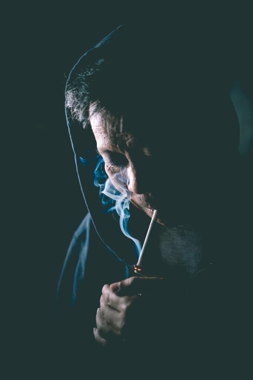 person igniting cigarette