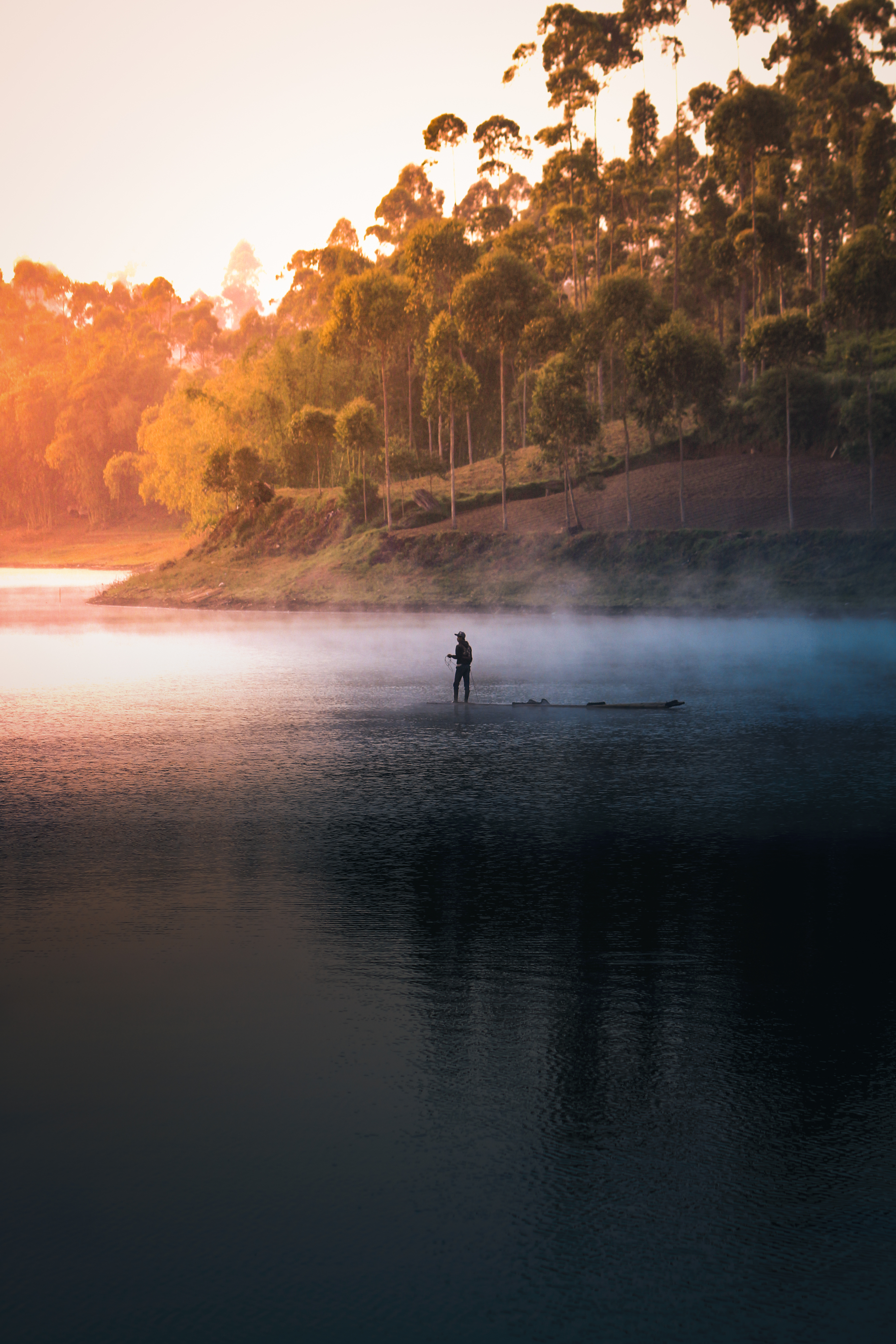 Person In The Middle Of Lake