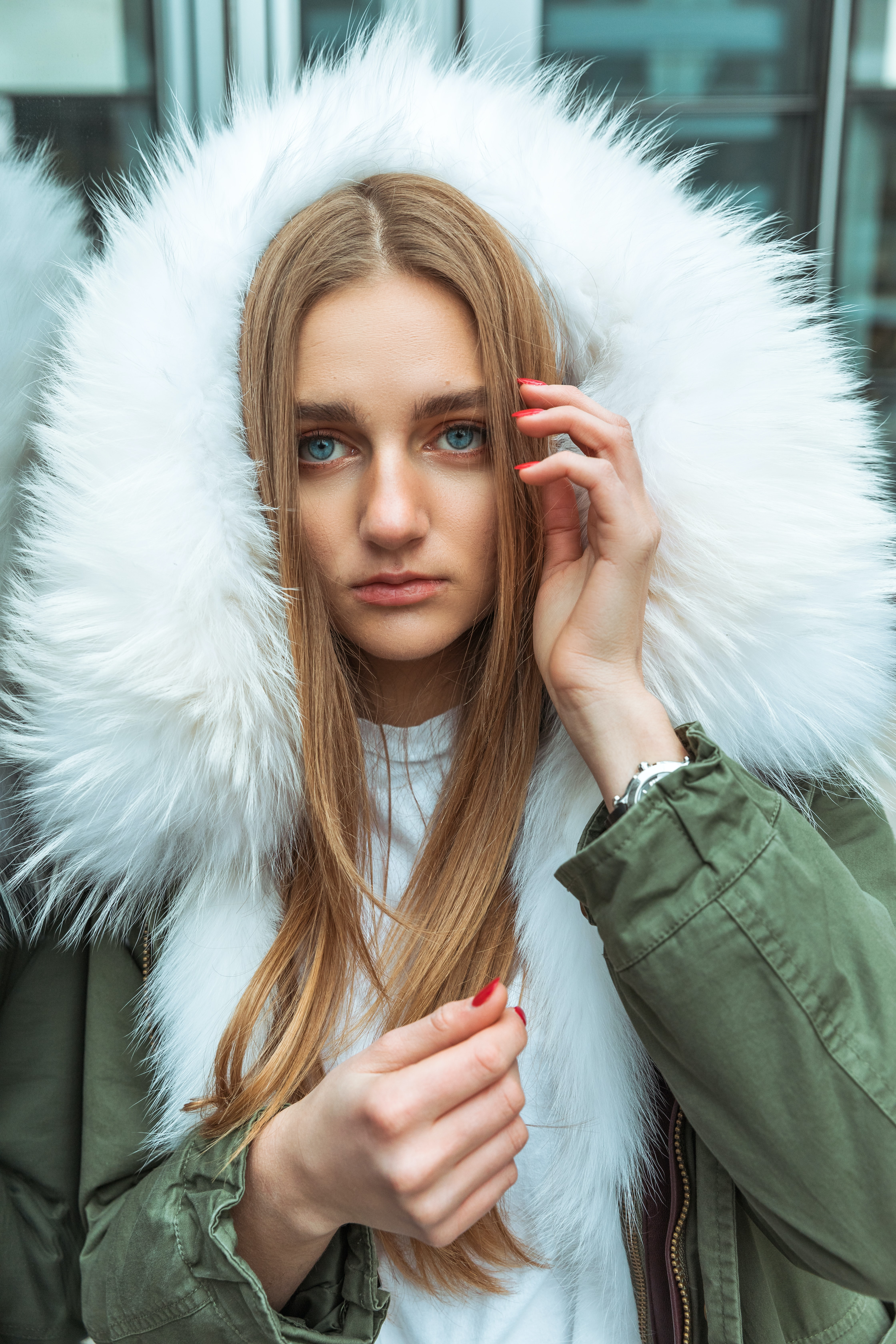 woman wearing gray and white parka jacket