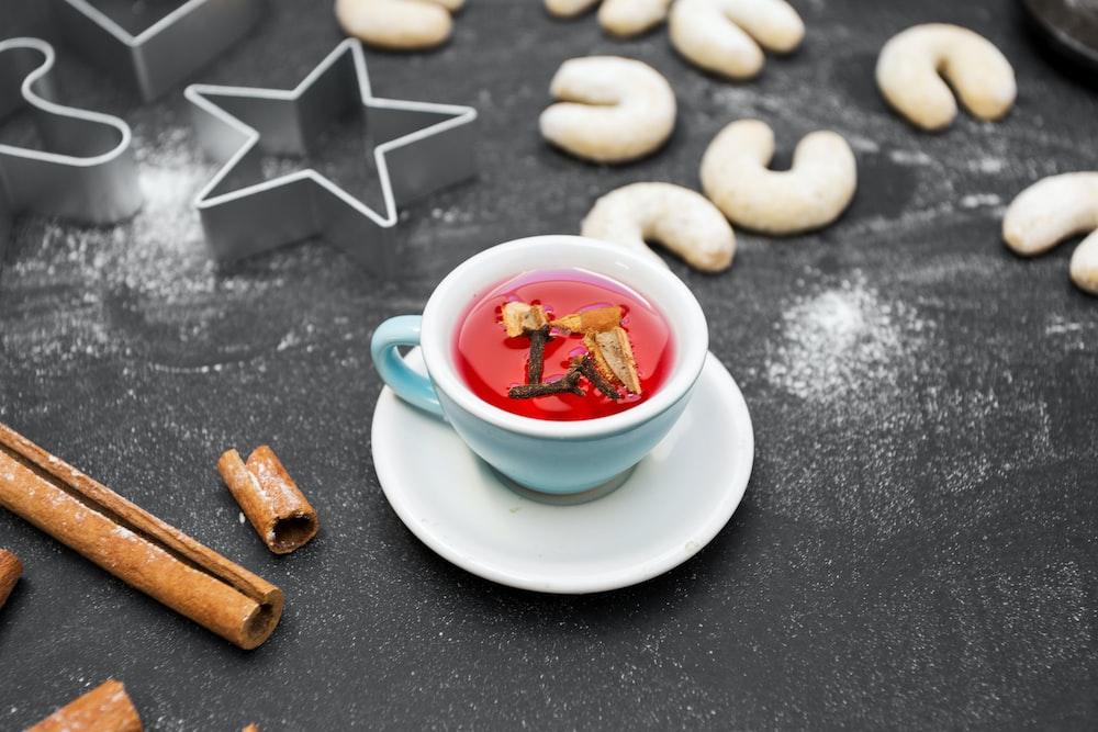 white ceramic teacup on saucer