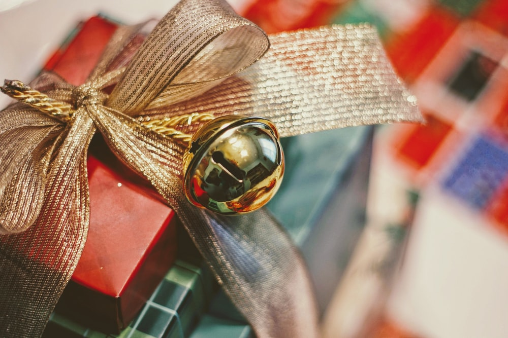 red and gold gift box closeup photography