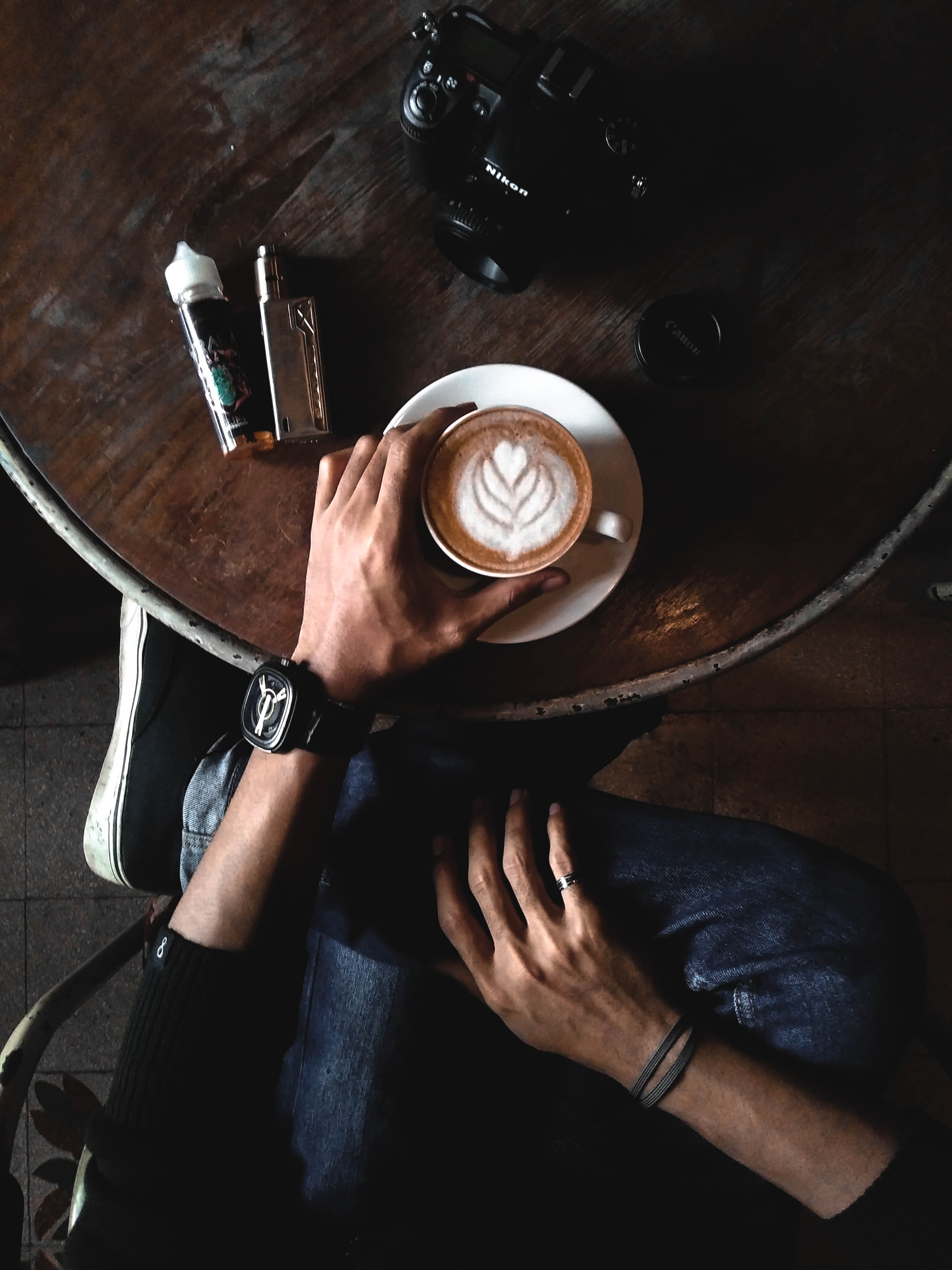 person holding cappucino