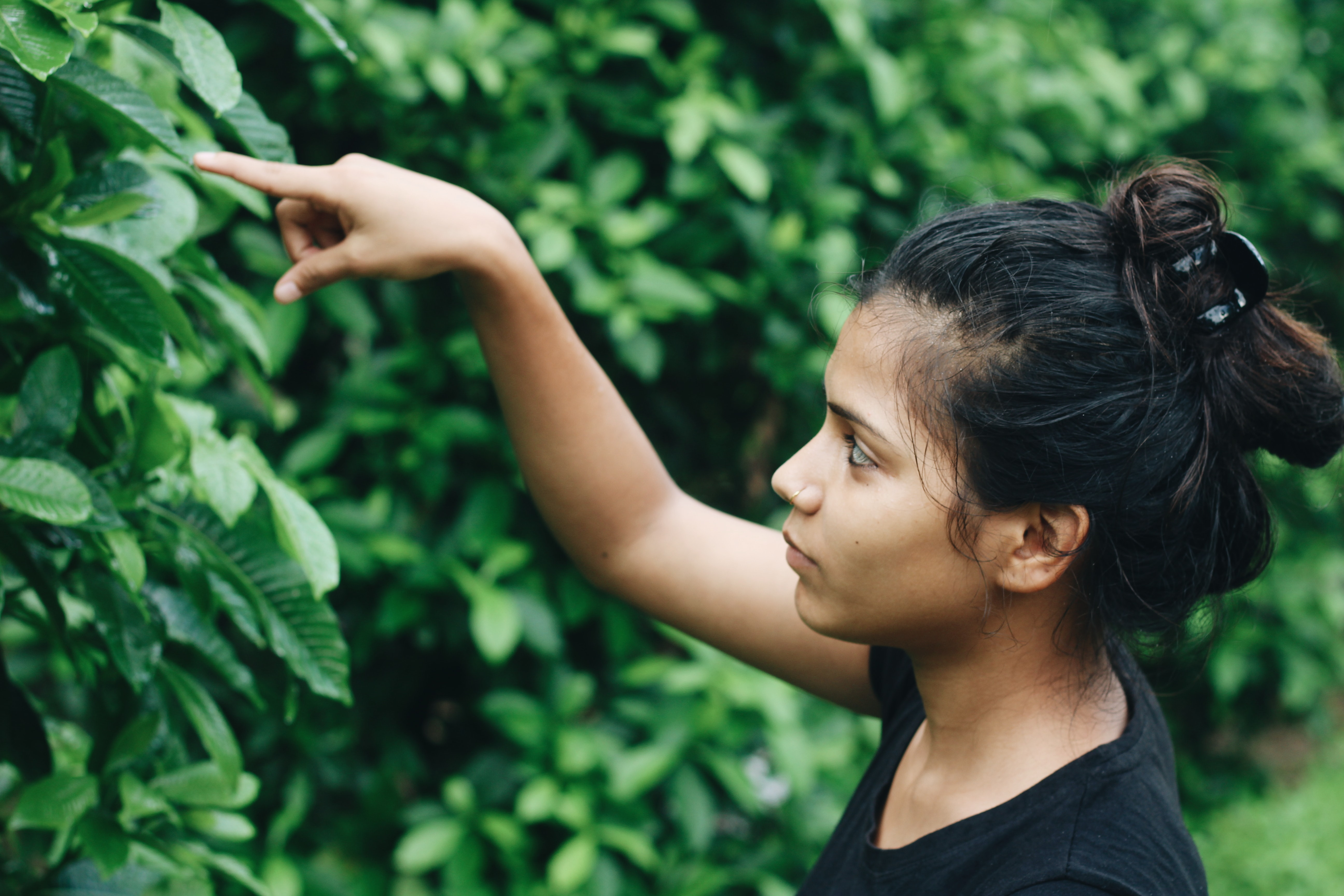 woman looking at the plant