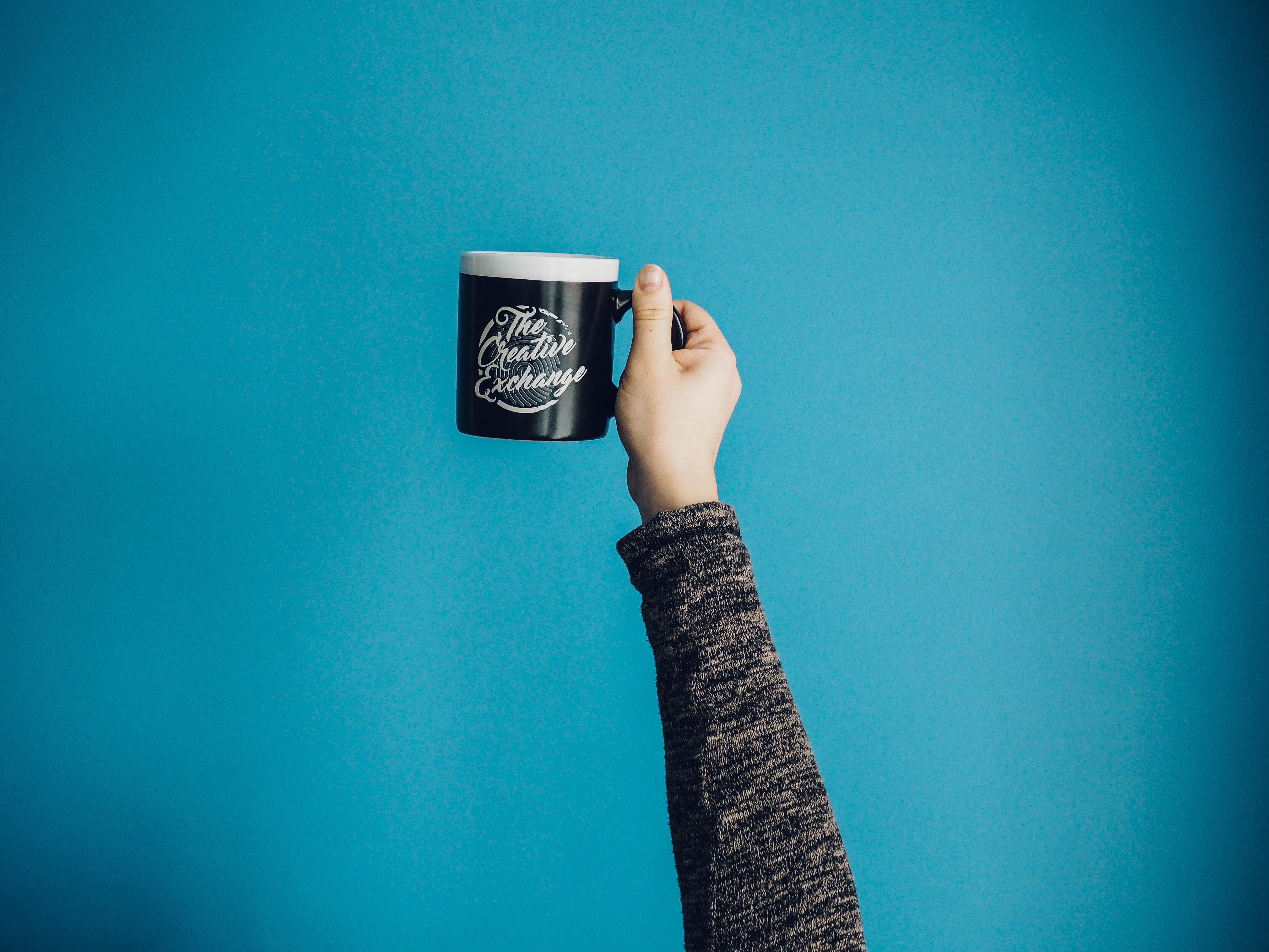 selective focus of person holding mug