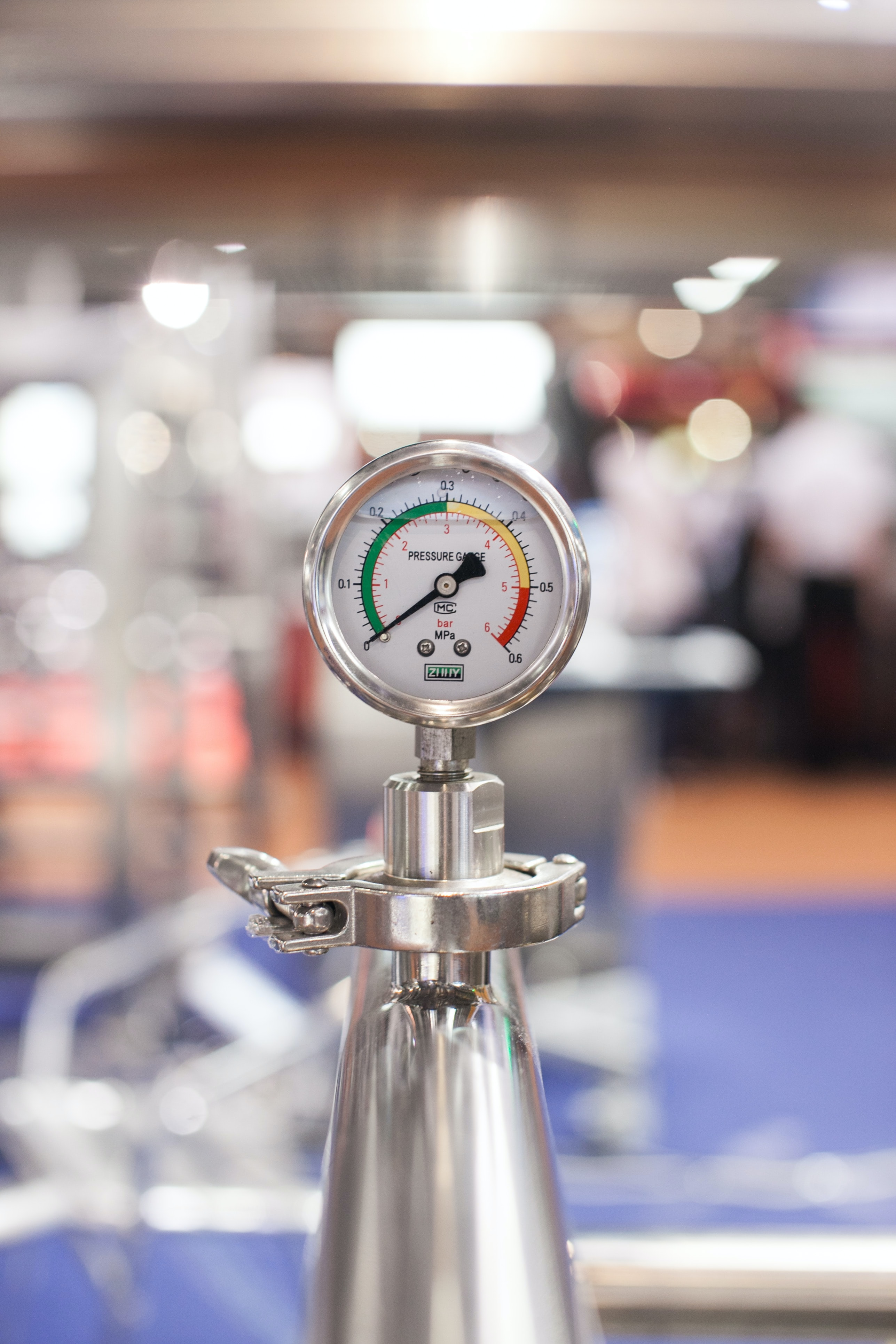 selective focus photography of gauge