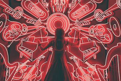 If you walk down Fifth Avenue in Manhattan at night around the holidays, you are there to see the high-end stores' window displays. This scene, one of many in the windows of Bergdorf Goodman, shows a woman conducting madness of music around her in what seems to be an all-too-fitting metaphor to close out twenty seventeen.