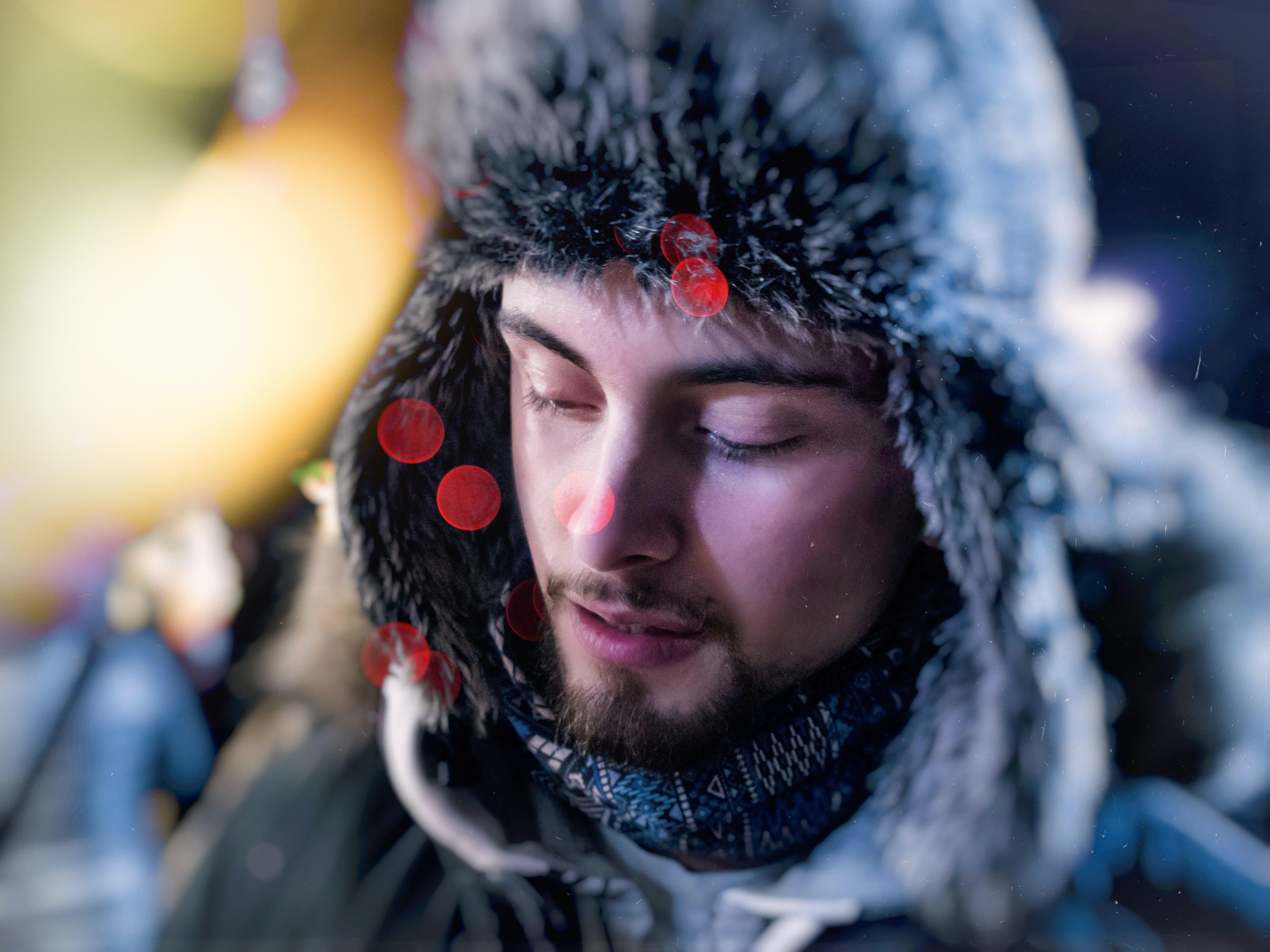 man wearing fur aviator hat