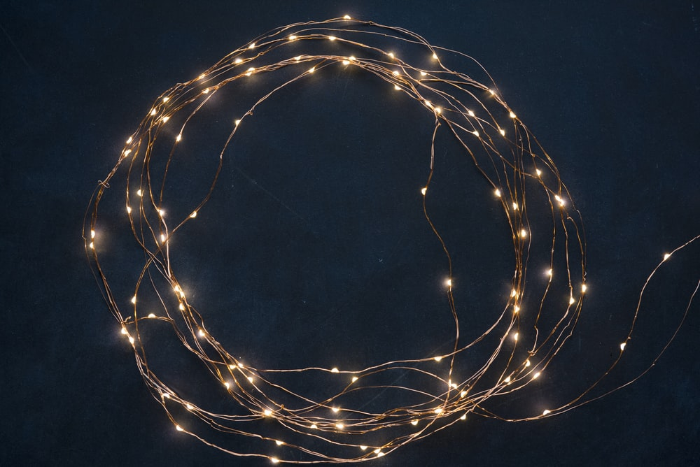 string lights on blue textile