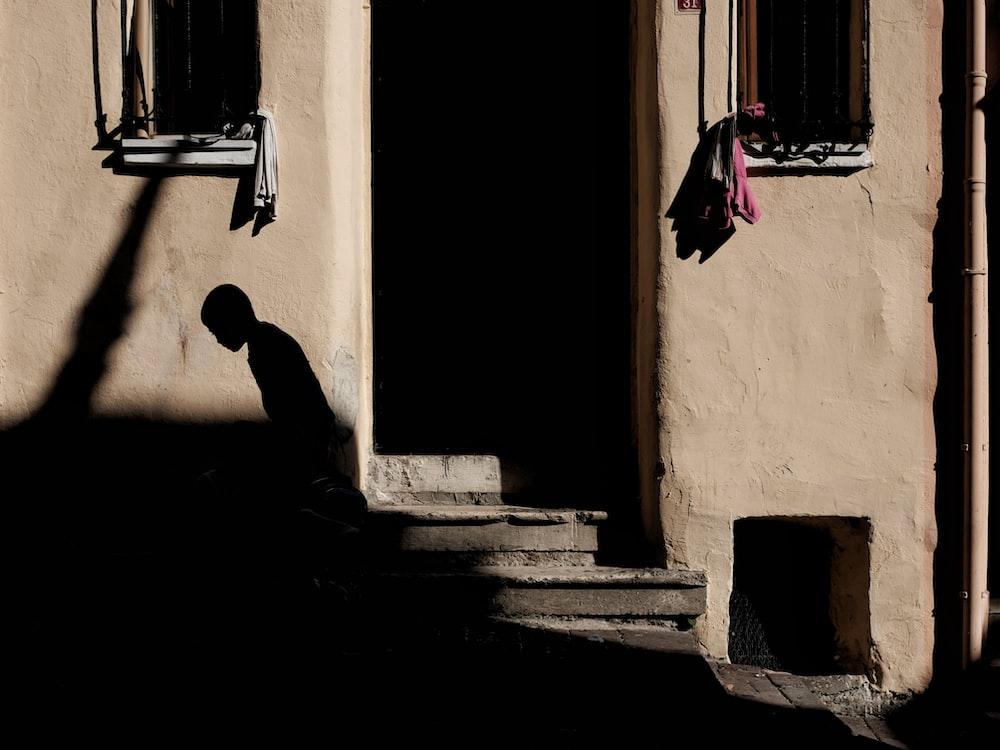 silhouette of person beside door