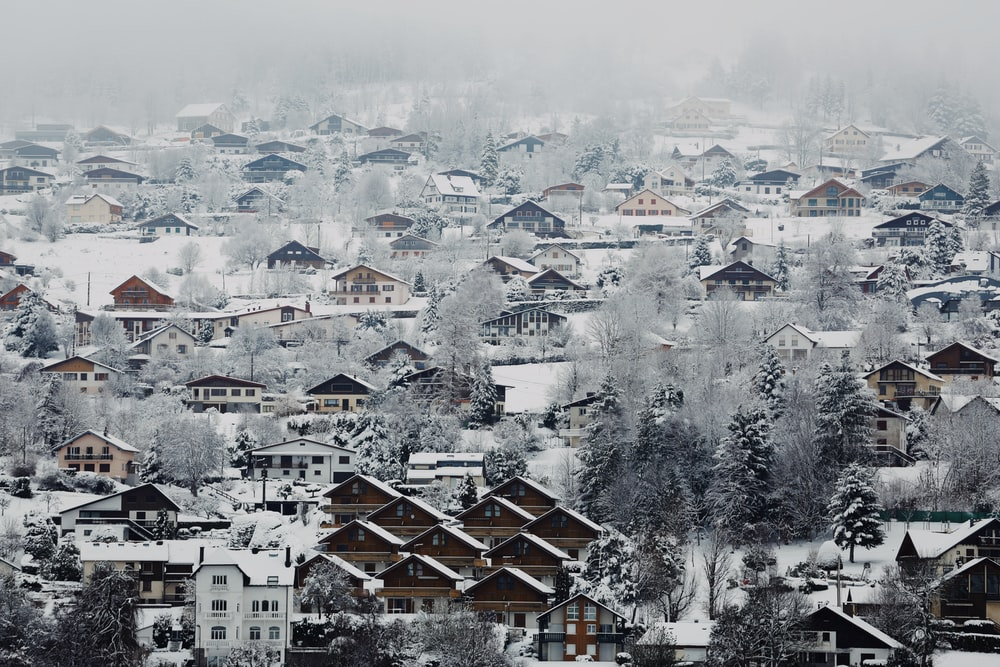 aerial view of village covered with snow