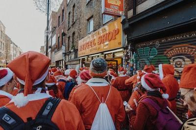 people wearing santa costume on road santa zoom background
