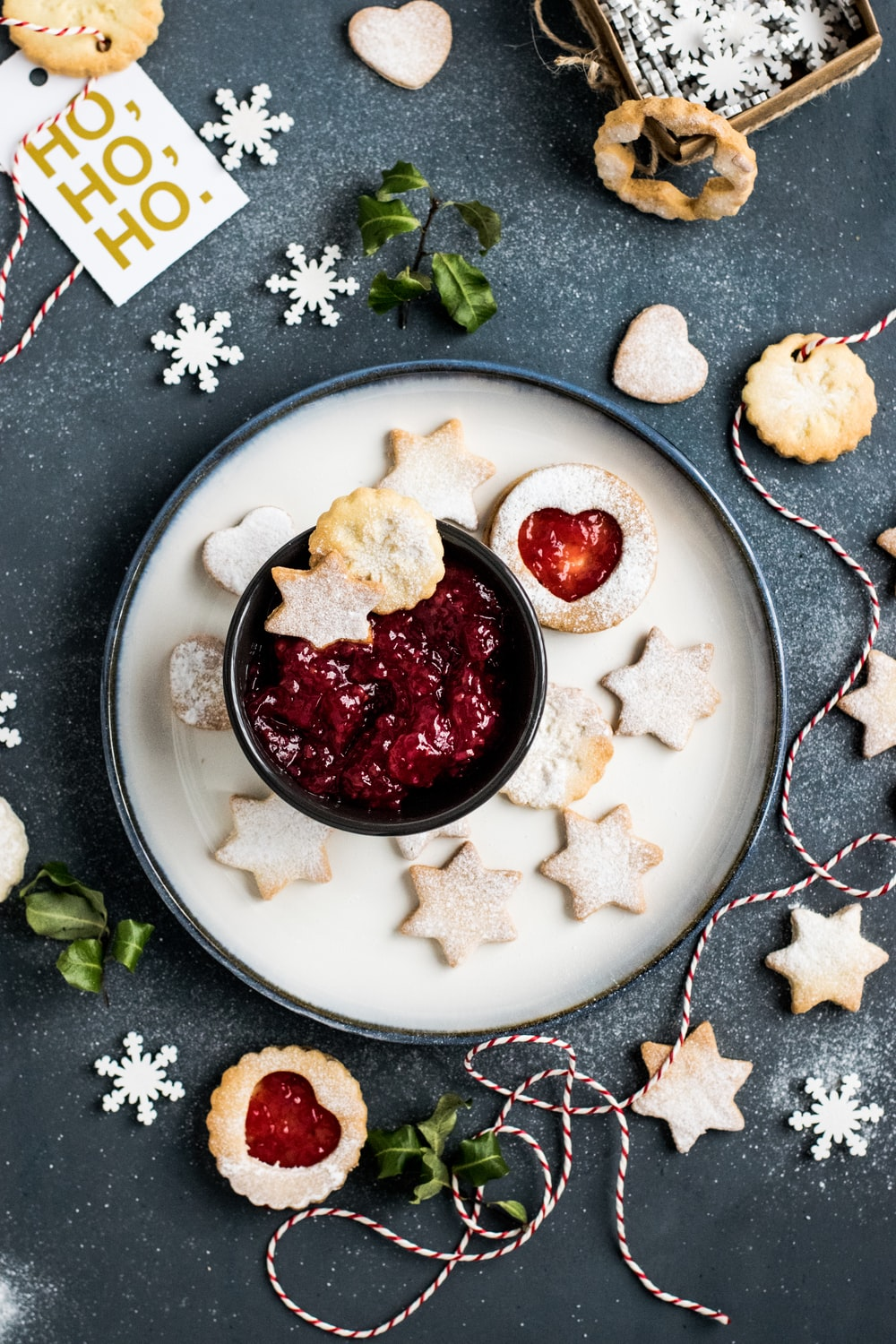 strawberry jam with star biscuits on plate