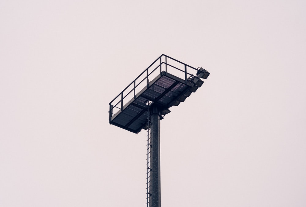 low angle photo of black metal tower at daytime