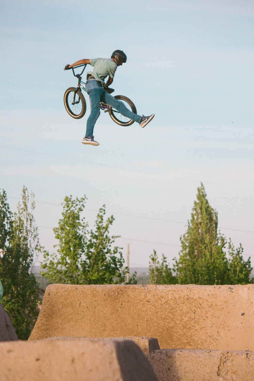 man doing tricks on BMX bike