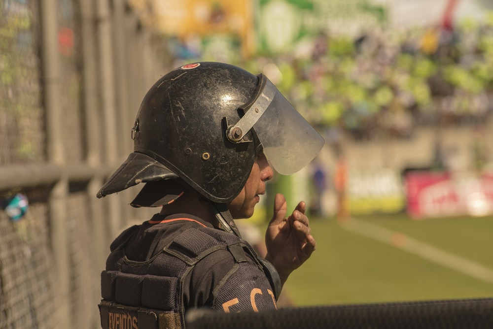selective focus photography of man wearing helmet