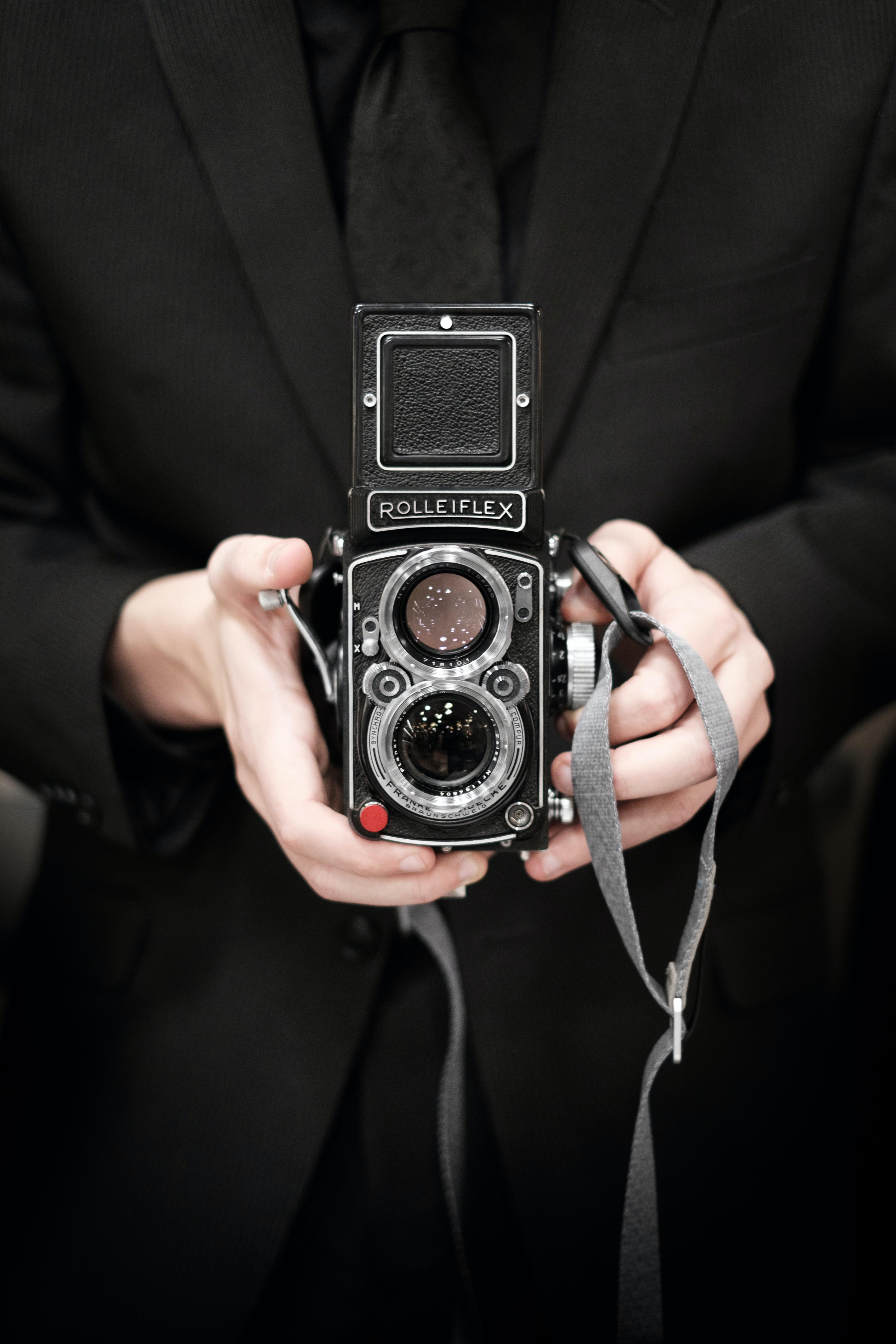 person holding Rolleiflex camera