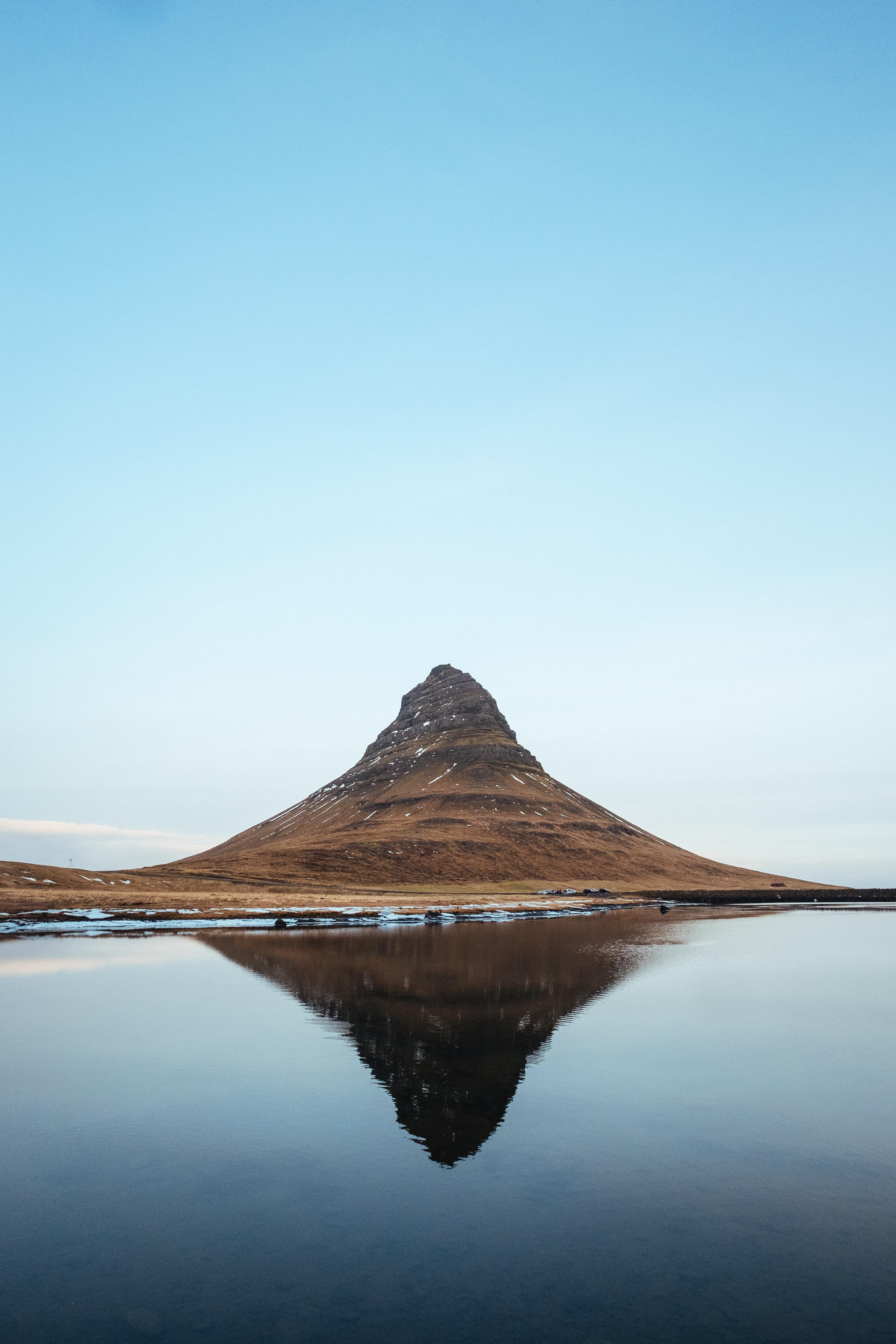 mountain near body of water photo