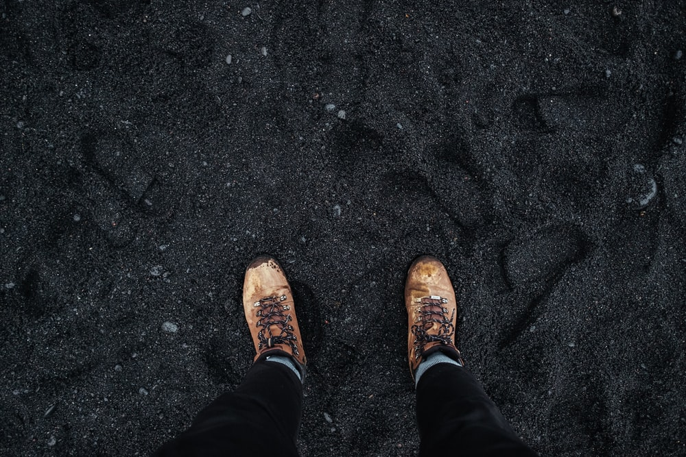 person wearing brown low-top shoes