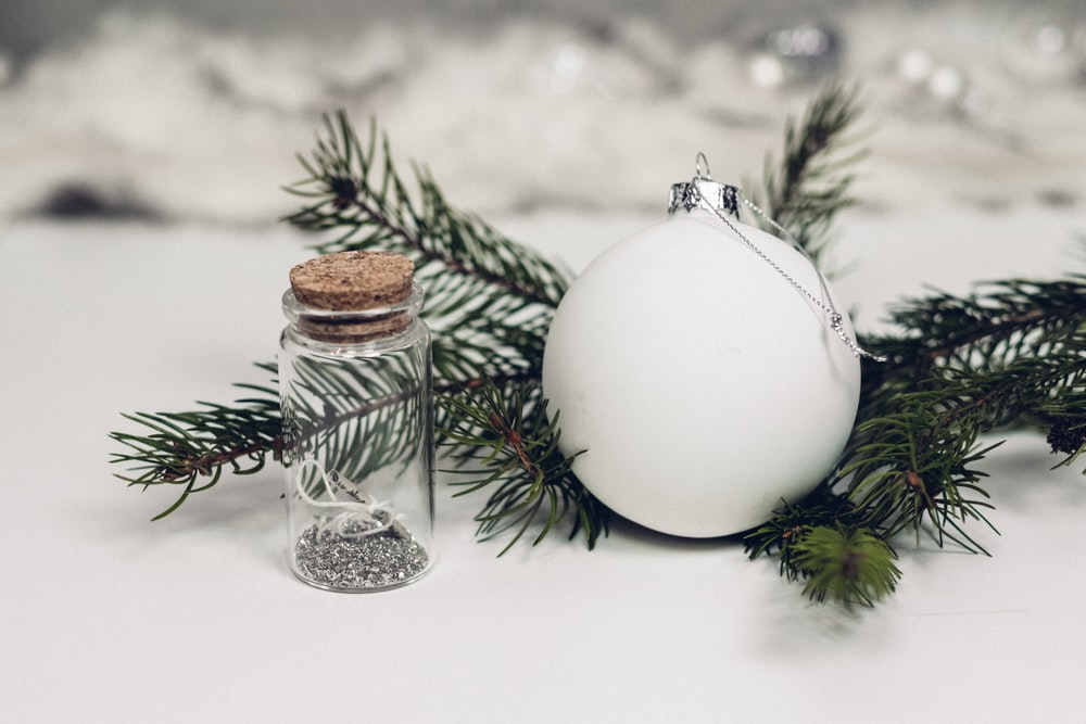 white bauble on top white surface