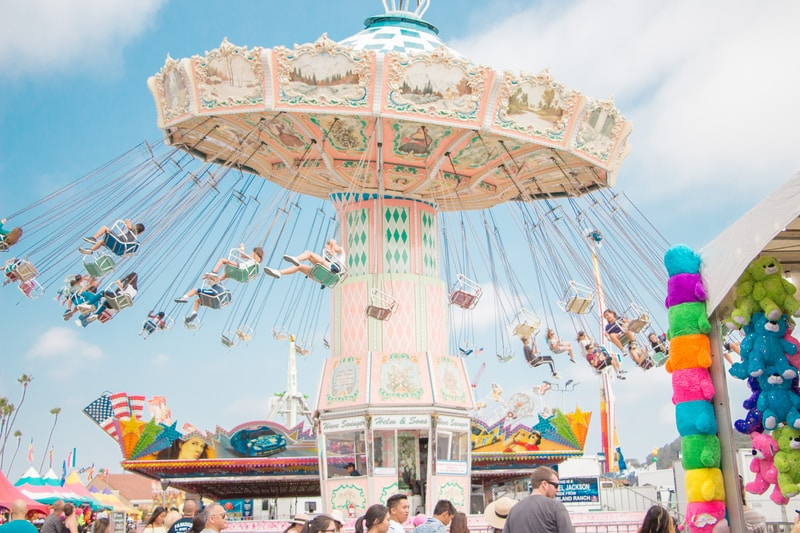 people riding on coaster at daytime