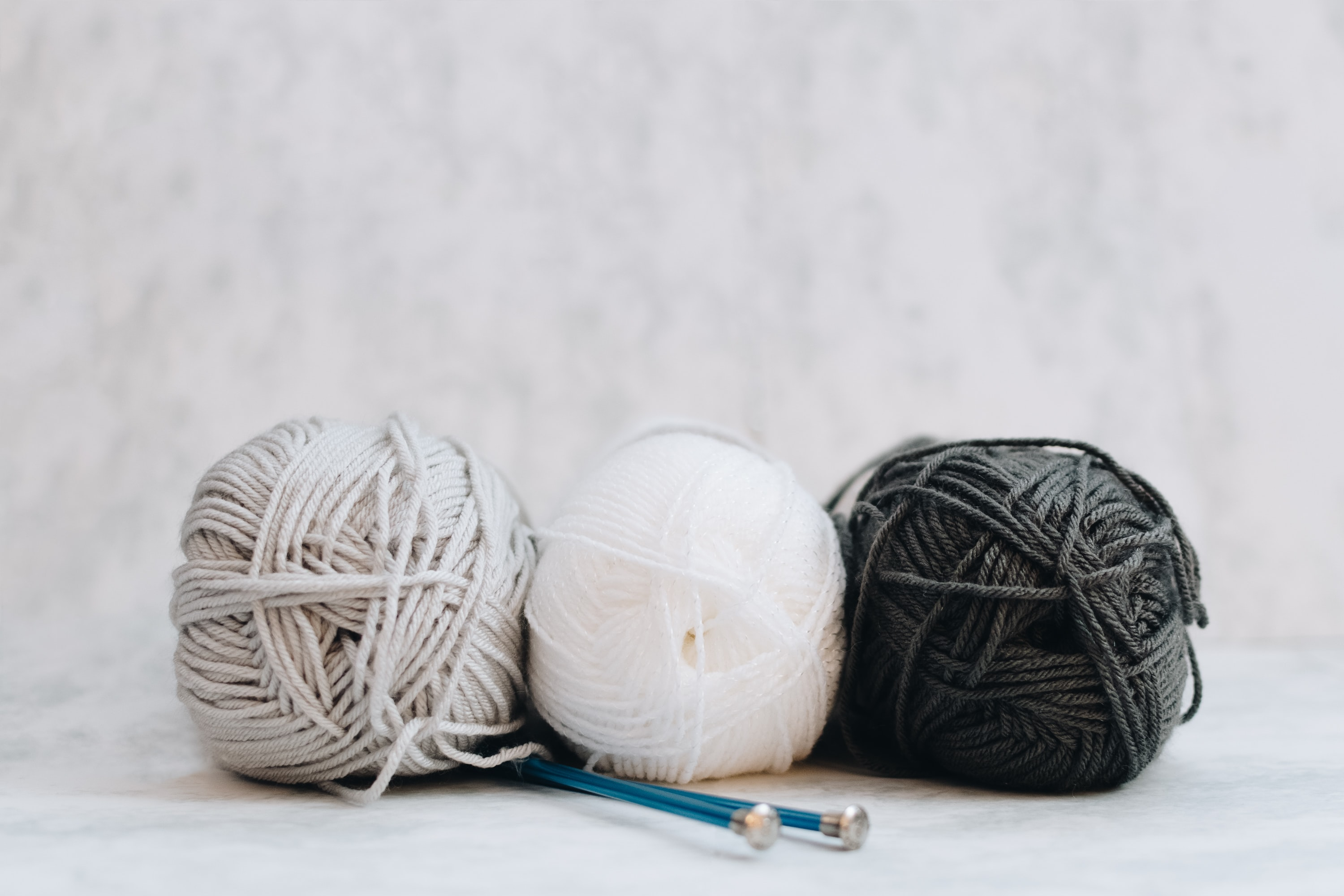 white, gray, and black yarns