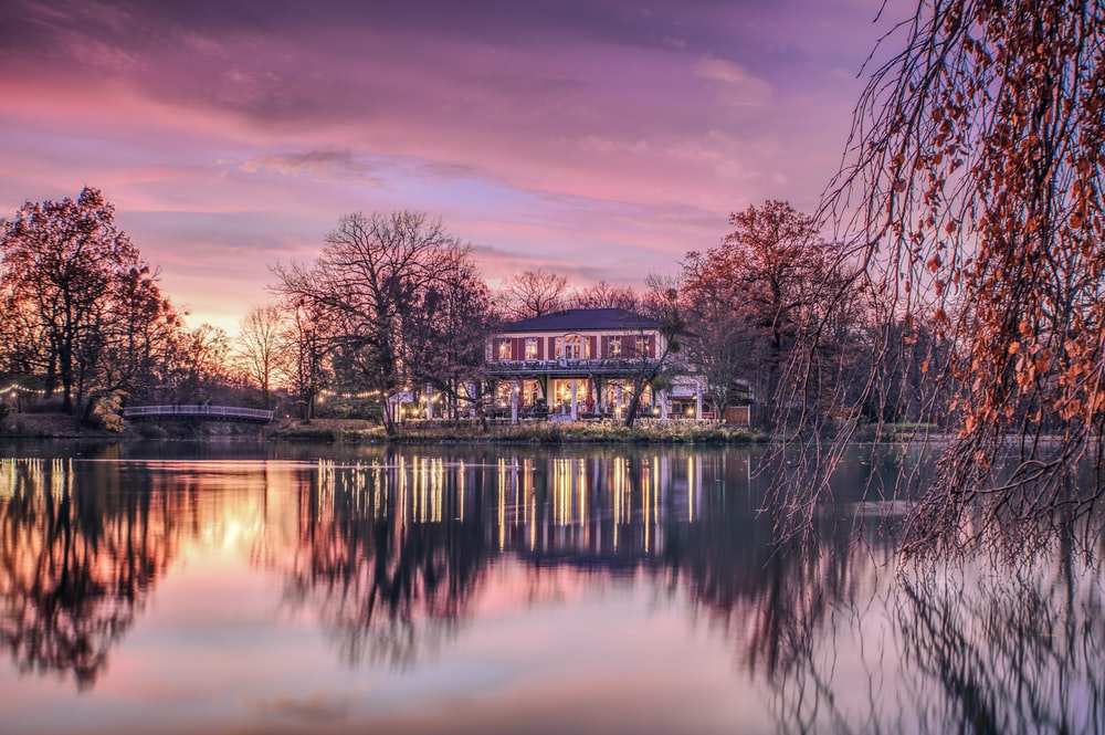 gray house beside body of water