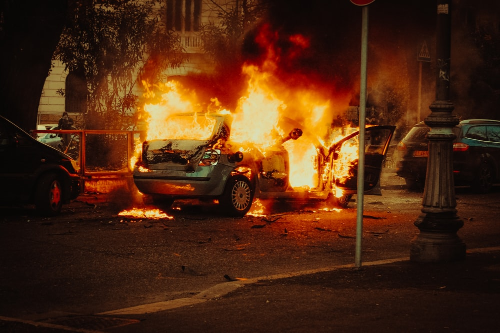 broken car covered with flame
