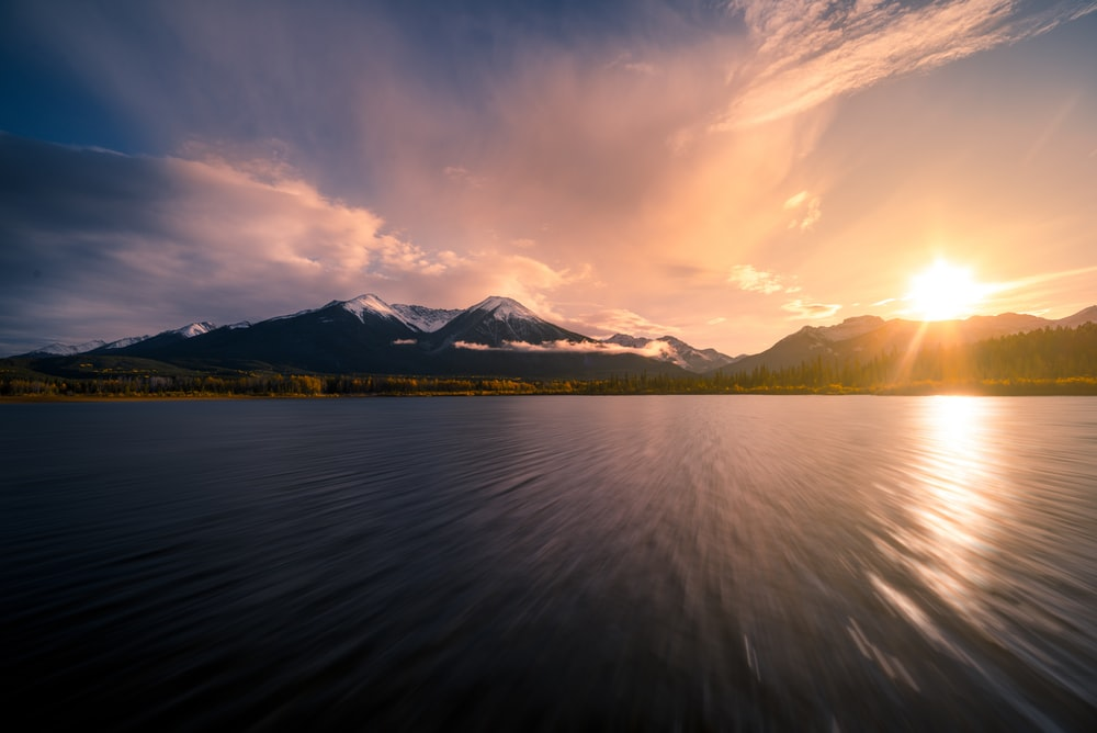 calm body of water during sunset
