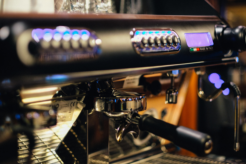 selective focus photography of black espresso machine