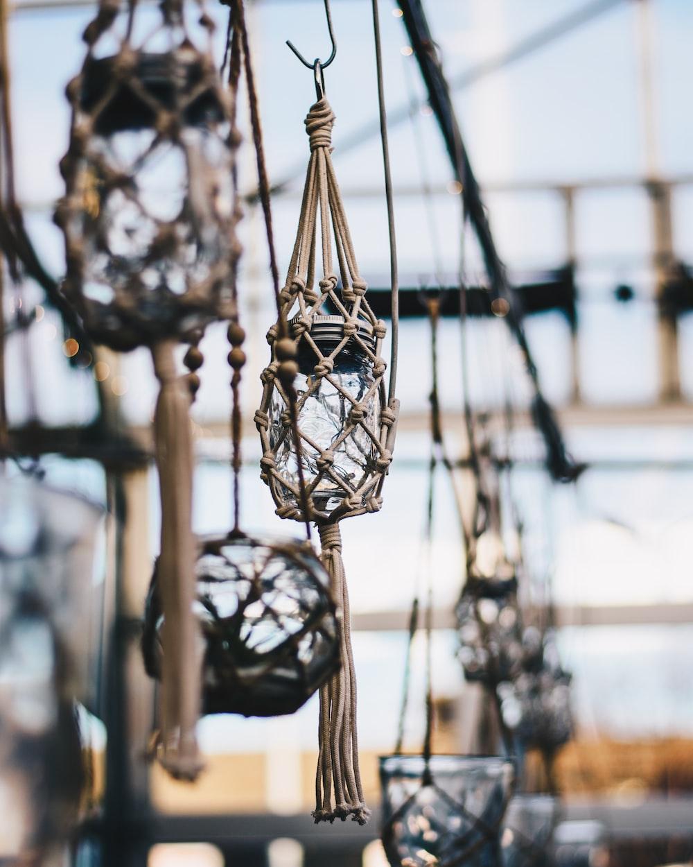 shallow focus photo of hanging glass jar decor