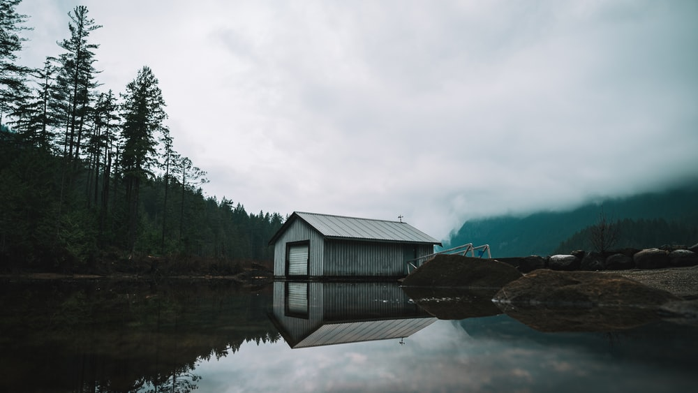 boat shed beside the lake and trees