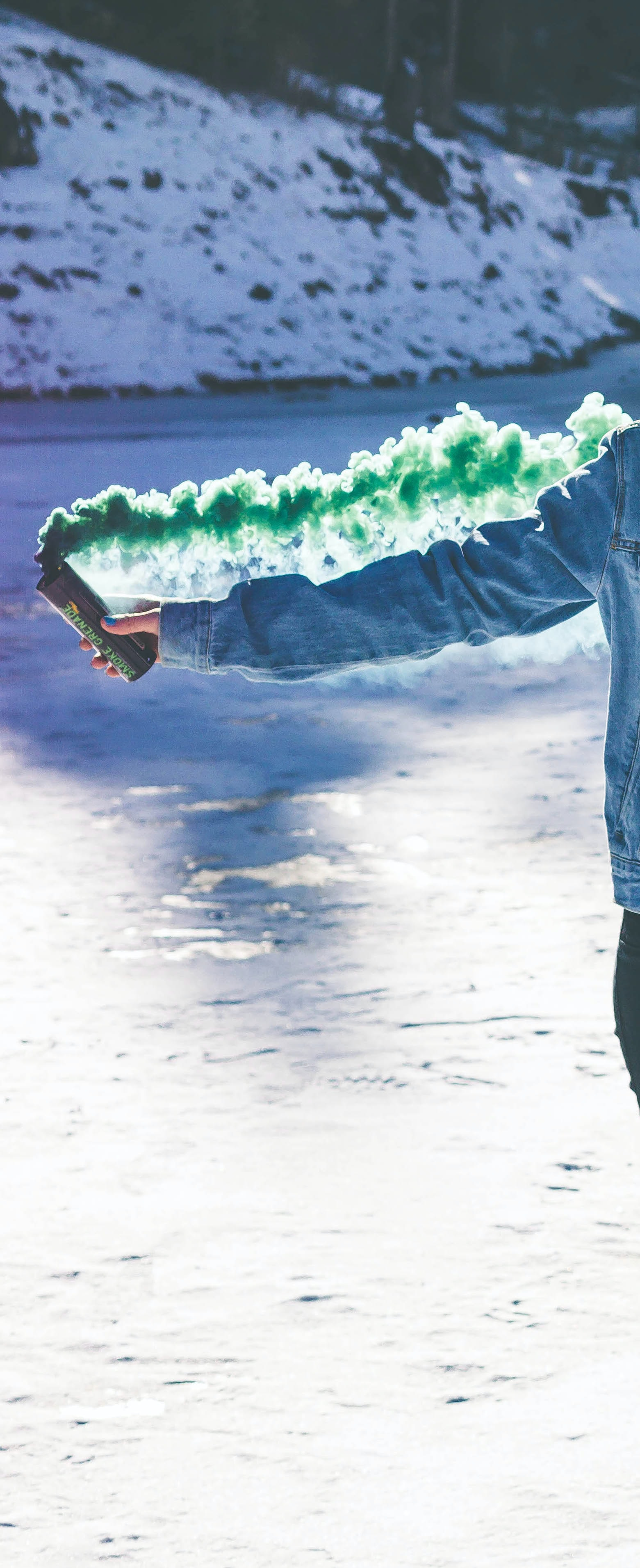person holding green smoke can