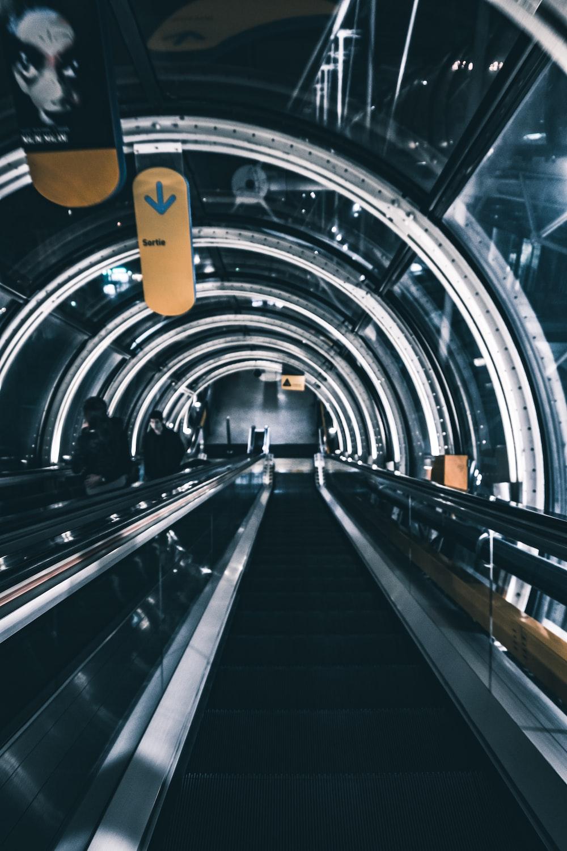 photography of interior escalator building