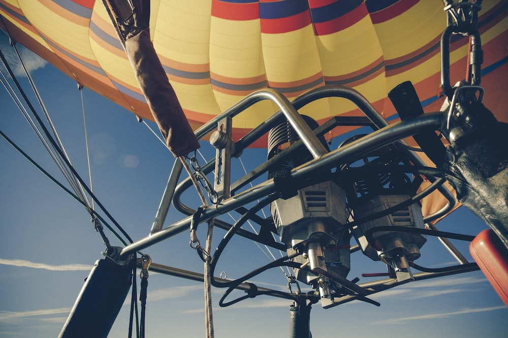 multicolored hot air balloon under blue sky during daytime