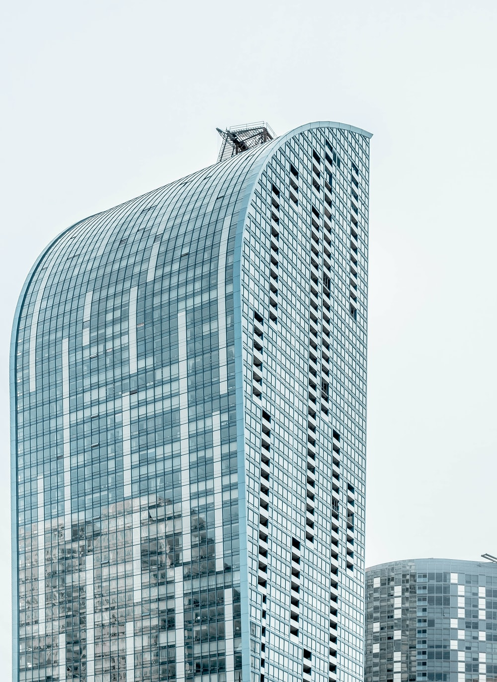 blue and clear glass building during daytime