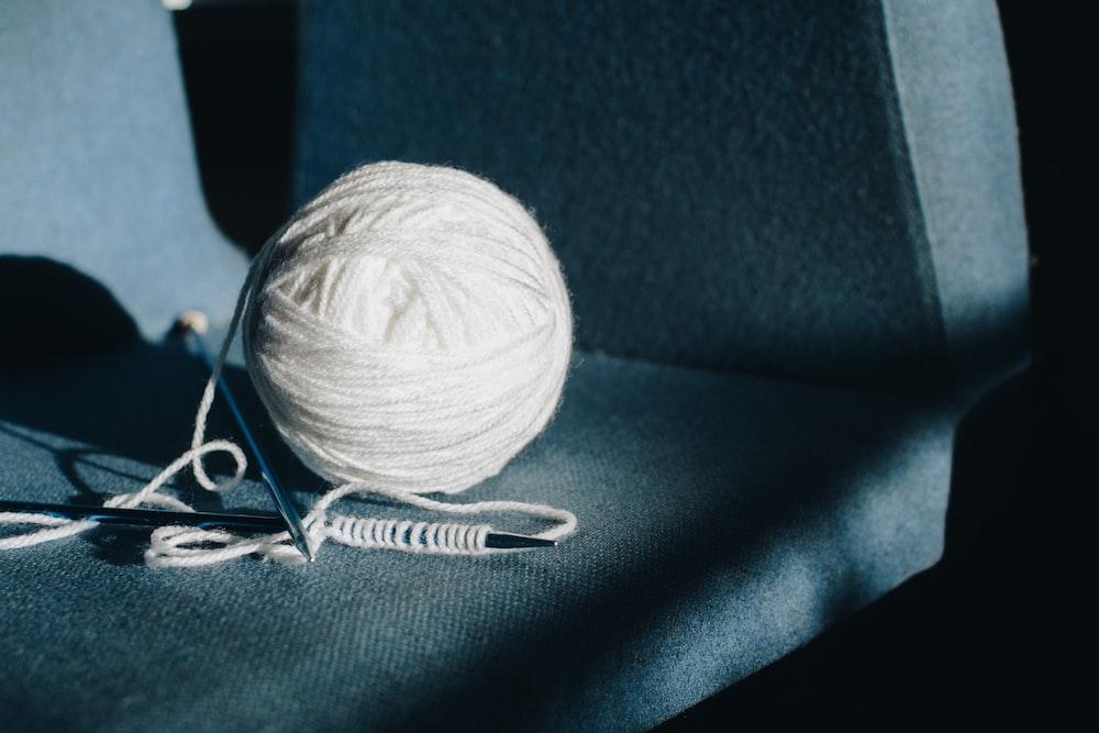 white yarn on gray surface
