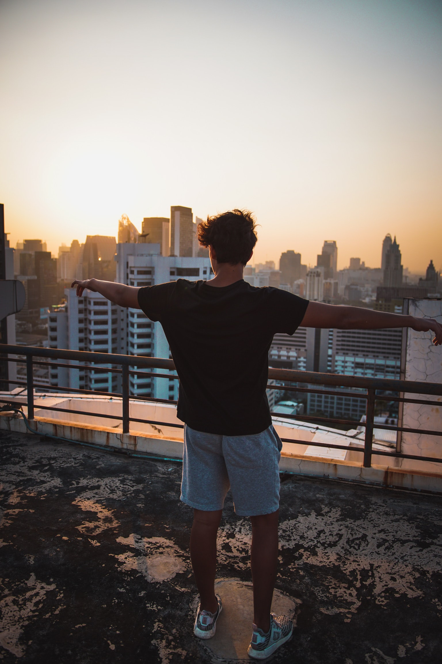 man wearing black T-shirt during sunset