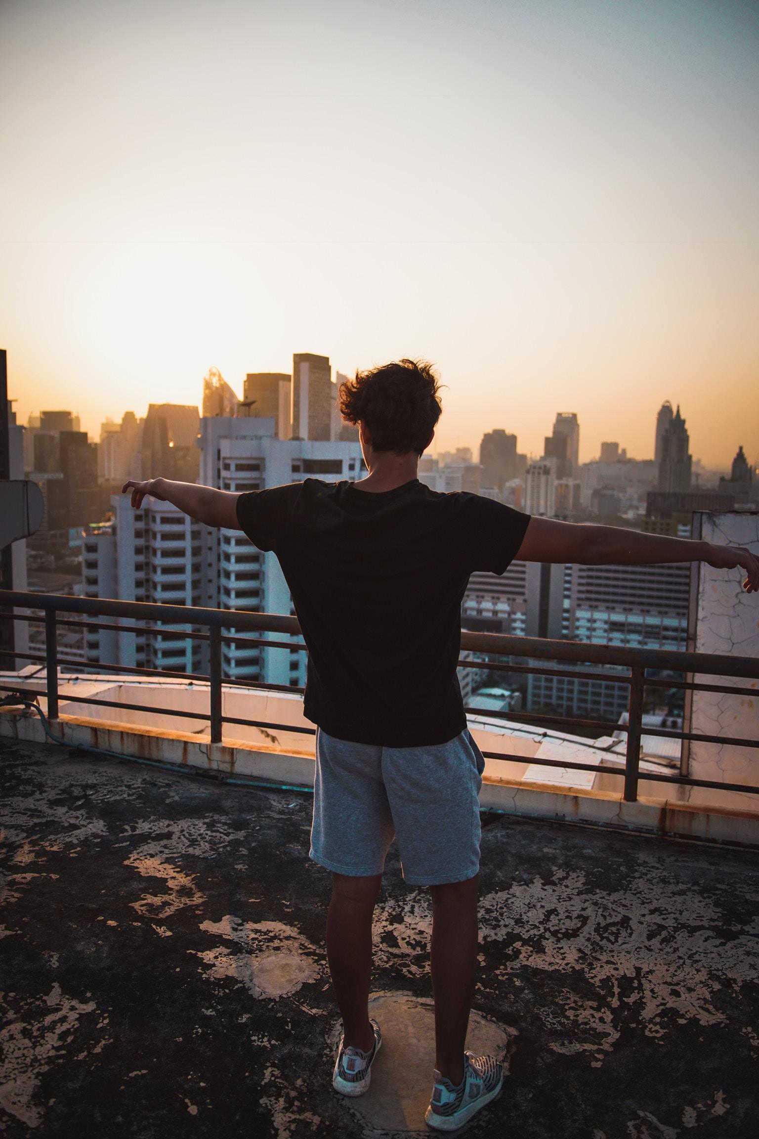 man wearing black T-shirt during sunset