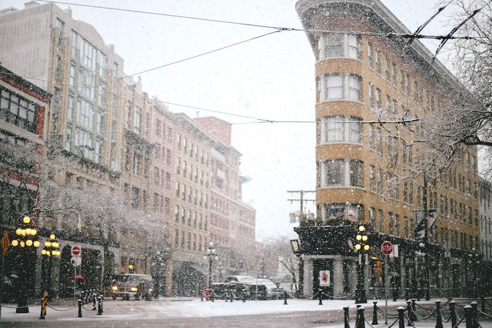 concrete road beside building during winter season