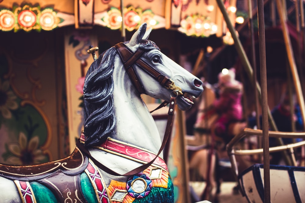 white carousel closeup photography