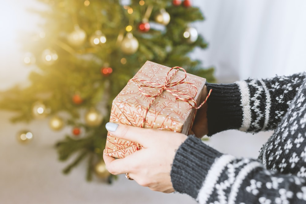 person holding gift box