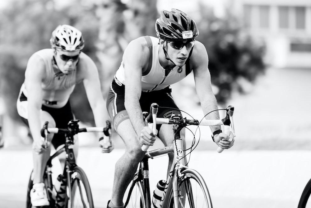 two men riding road bike