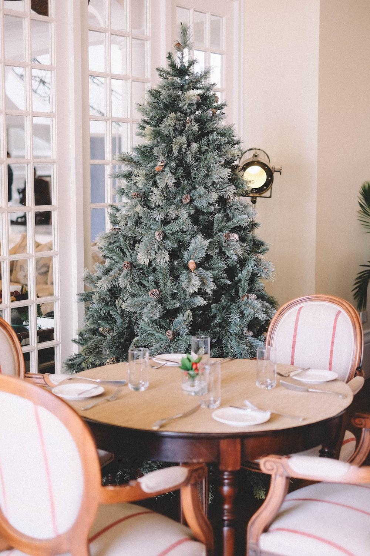 pre-lit tree behind dining set