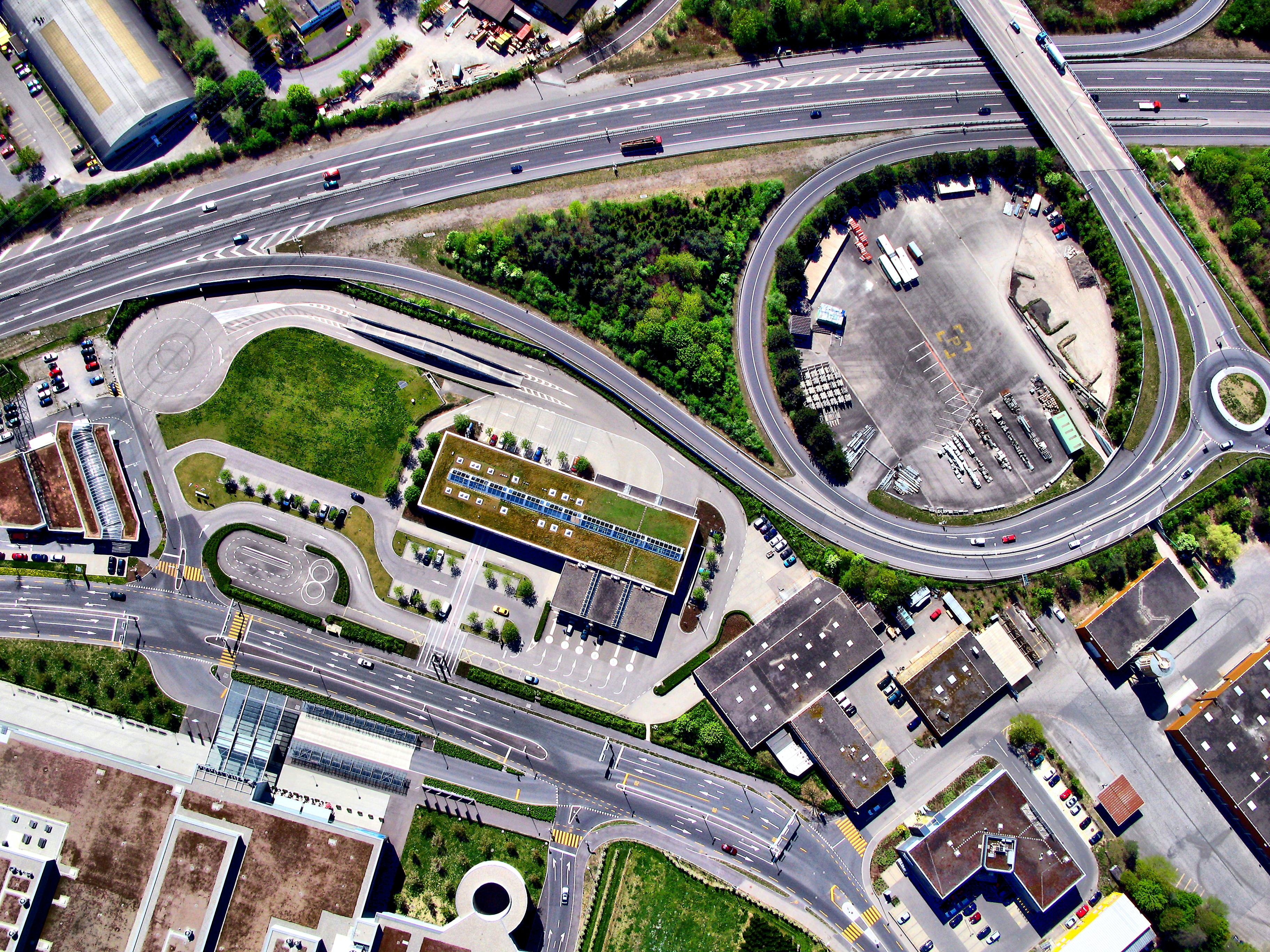 aerial photography of highway with buildings