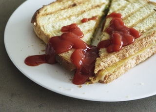 sandwich with ketchup on white plate