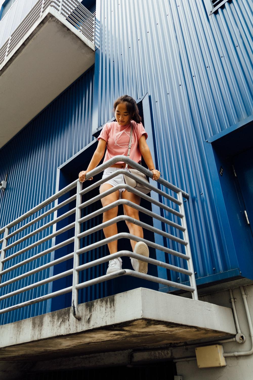 woman standing on gray railing