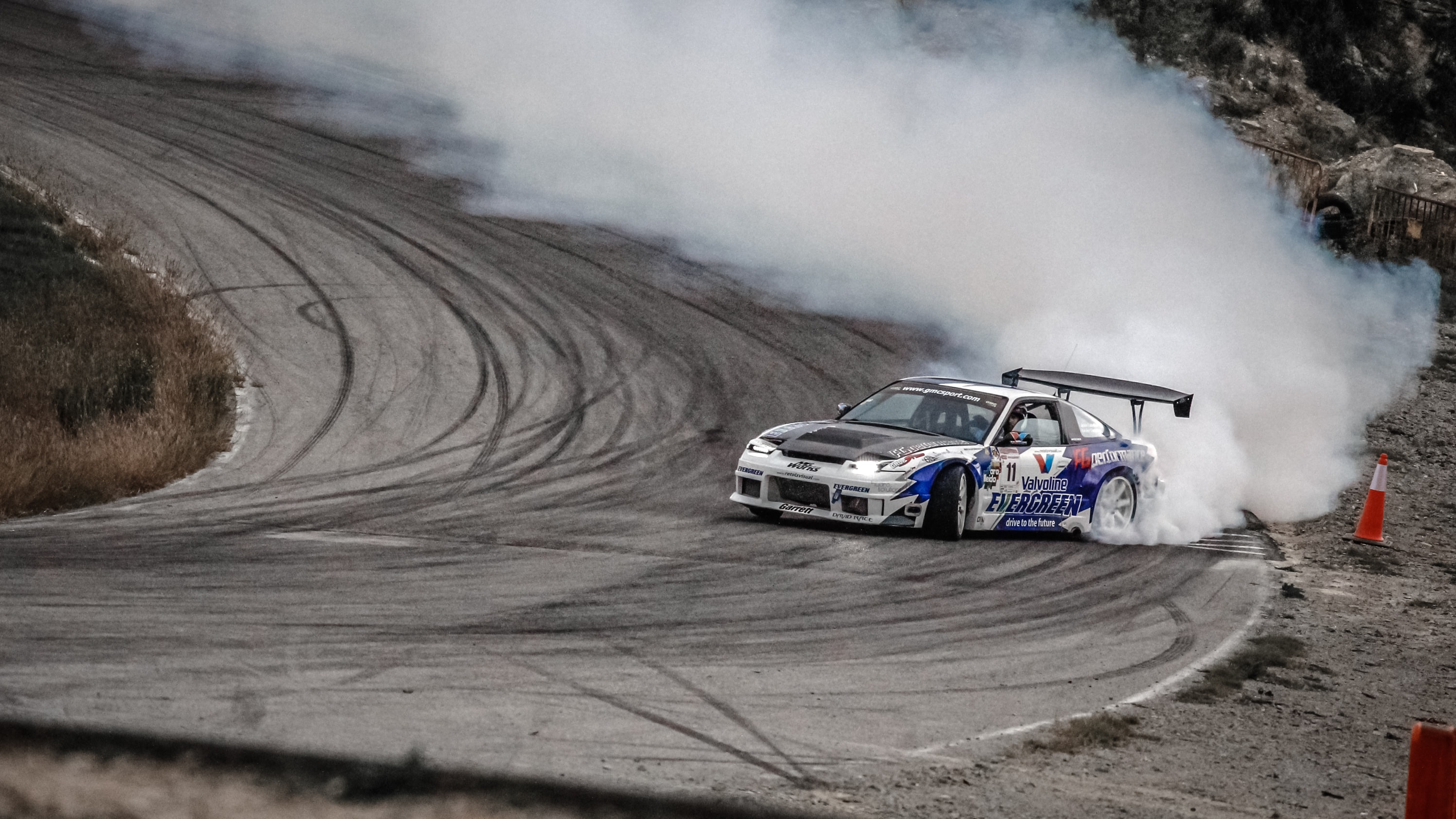 white and blue car drifting on wall