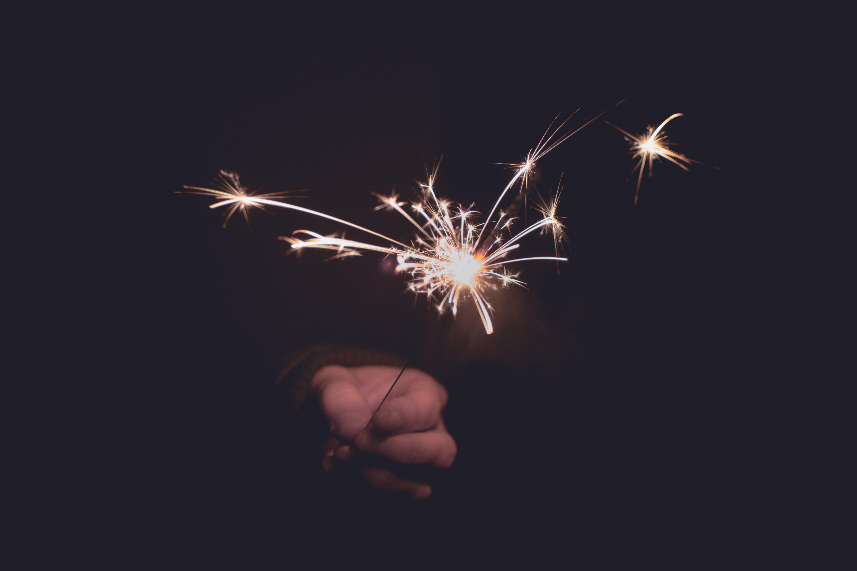person holding sprinkler firecracker