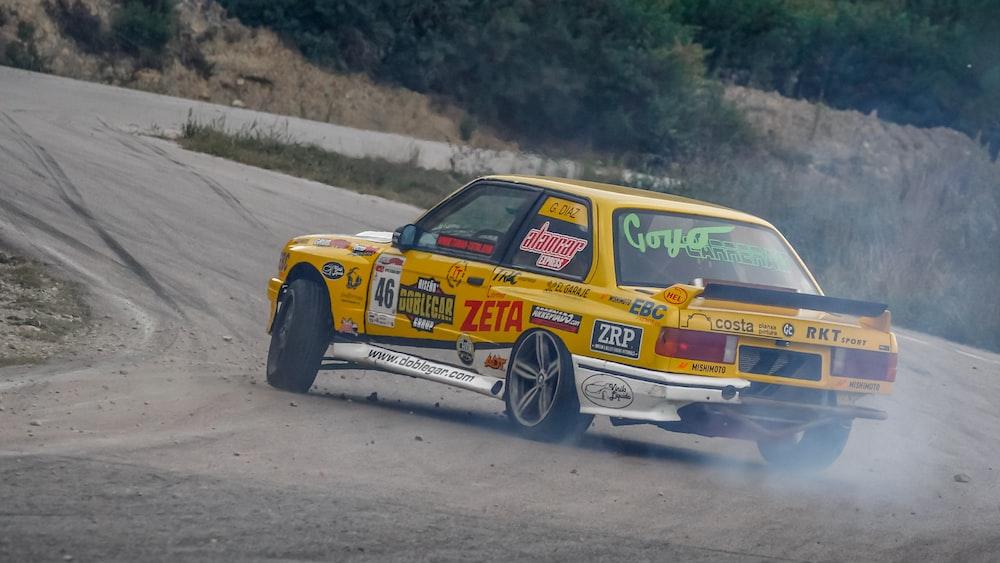 yellow racecar on road